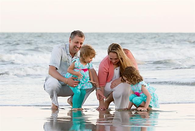 Amico, her husband Andrea, and their two daughters