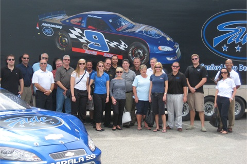 Auction Academy students, staff, and sponsors with auction personnel during tour of Sanford Auto Dealers Exchange.