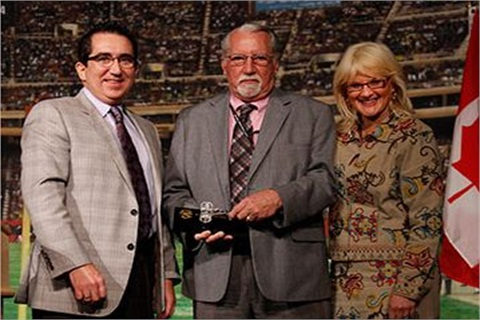 (Left) Joe Pyle, owner - Mountain State Auto Auction; Jerry Girvin, 2012 Bernie Hart Memorial Auctioneer Award recipient; and Charlotte Pyle, NAAA President.