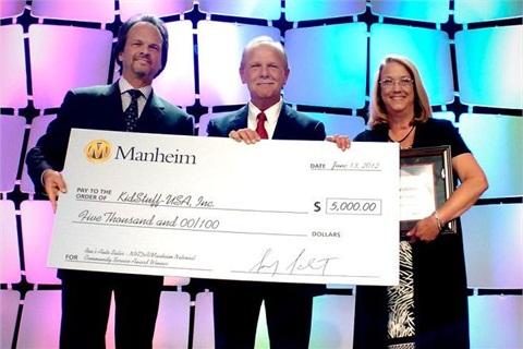 (L-R) Nick Peluso, Manheim; Ron and Debbie Ringdon from Ron's Auto Sales.