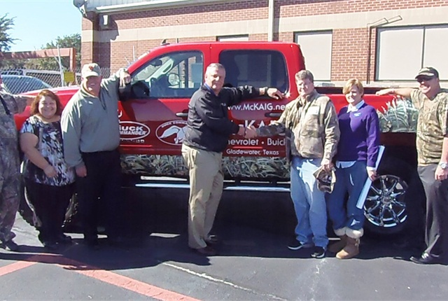 Standing in front of what was Willie Robertson's truck (L-R) Eddie Pope, Manheim Dallas assistant general manager; Christy Lopez, Manheim Dallas promotions; Wayne Carey, Manheim Dallas assistant general manager; David Robertson, Manheim Dallas general manager; Kent Abernathy McKaig, Chevrolet Buick; Susie Scadden, McKaig Chevrolet Buick; Noel Kitsch, Manheim Dallas asst. general manager. (Not pictured) Joe Walton of Walton Automotive Group, LLC, who purchased the truck online.