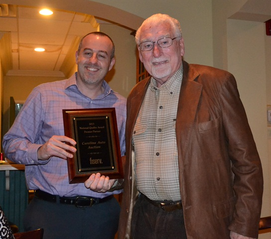 Steve Bissett, VP of Operations/Lending Solitions for Fiserv (left) presents the award to Henry Stanely, owner of Carolina Auto Auction. (PHOTO: FISERV)