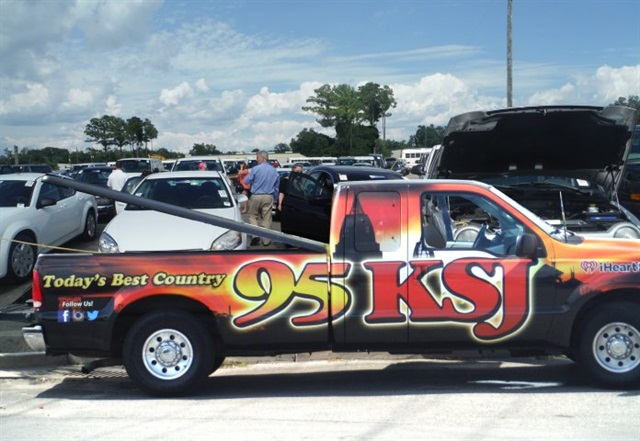 Local 95 KSJ radio personality Colton spent a day at DAA Mobile encouraging the public to preview the lot full of GSA vehicles going to auction. (PHOTO: DAA)