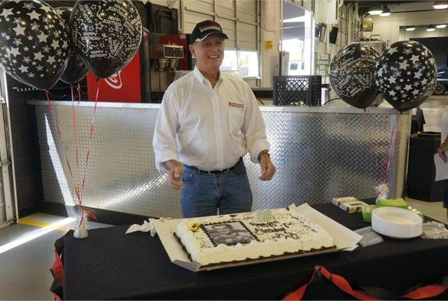 Racing legend Bob Bondurant was presented with a cake as he celebrated his 80th birthday at the auction.