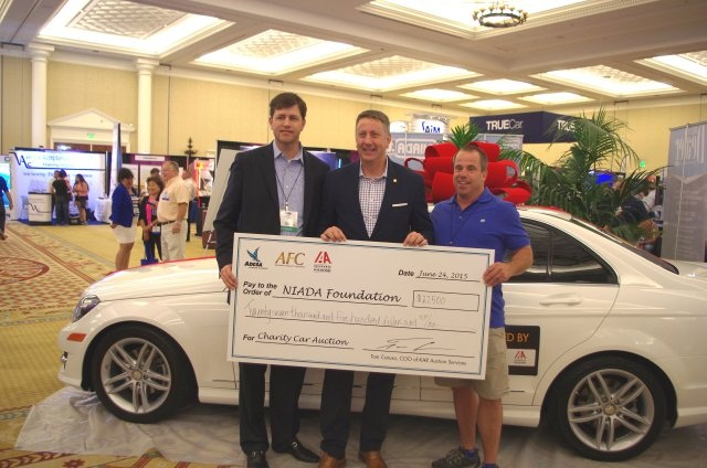 (L-R) John Hammer of AFC, NIADA executive vice president Steve Jordan and auction winner Andy Gabler of Lakeside Auto Sales in Erie, Pa., with the 2013 Mercedes C250W. (PHOTO: NIADA)
