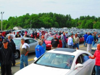 Customers preview inventory at the Dealer Appreciation Sale at Auto Auction of New England. (Photo: ServNet)