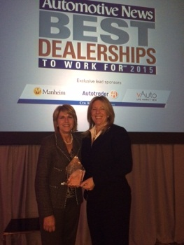 Presented by Janet Barnard, president of Manheim North America (left), presents the Leader in Sustainbility Award to Milly Williams, general manager of George Matick Chevrolet. (PHOTO: Cox Automotive)