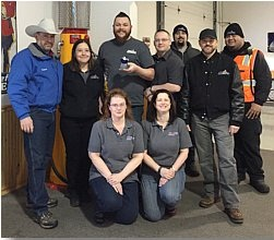 Auction owner Steve Sautner (second from right) and department manager Jason Sundberg (third from left) with DAA of Alaska's fleet/lease team. (PHOTO: ServNet)
