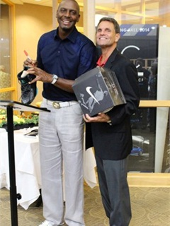 GE's Paul Seger (right) gets one of his auction purchases signed by its former owner, Penny Hardaway. (PHOTO: Dealers Auto Auction)