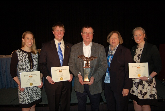 Jeff Barber (center) of State Line Auction was honored as the Remarketer of the year. His three children (l-r with certificates), Bethany, Paul, and Emily, were among the first graduates of the Auction Academy.