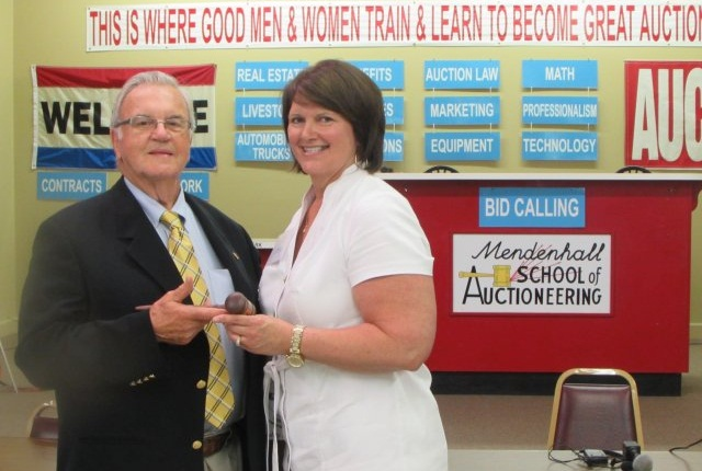Ellie Johnson received her diploma and gavel from Mr. Forrest Mendenhall at the graduation ceremony on June 14, 2015. (PHOTO: NAAA)