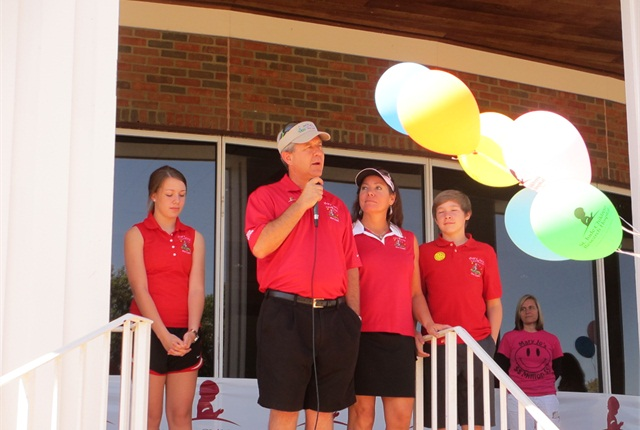 Dietsch addresses golfers at The 10th annual Mary Jo's Cure 4 Kids Golf Classic 2013 surrounded by his family.