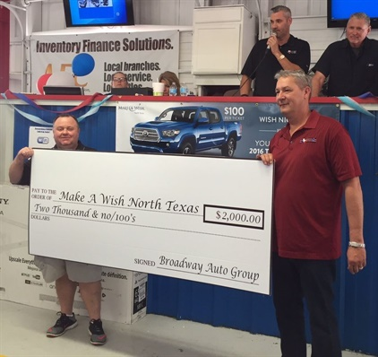 Texas Lone Star Auto Auction's General Manager Jeff Dunning (holding check on right) accepts one of the checks from the many dealers attending their charity fundraising sale for Make A Wish in North Texas. Photo courtesy of XLerate Group auction.