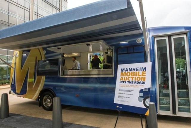 "The new mobile units feature a new portability set-up that allows dealers to remove the ""auction in the box"" unit from the vehicle and facilitate an auction anywhere there is demand. (PHOTO: Manheim)"