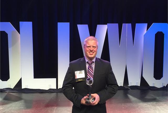 Noah Jaehnert accepts the ISLA award.